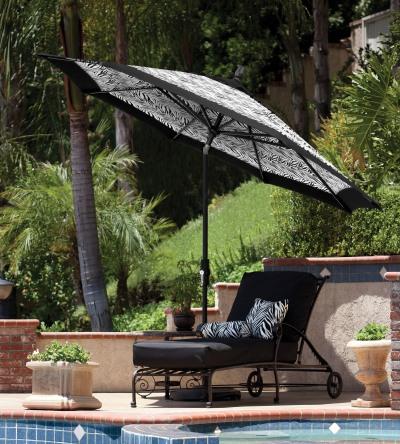 The 9-foot Collar Tilt umbrella with a matte black frame and Outdura Black Zebra fabric from Treasure Garden