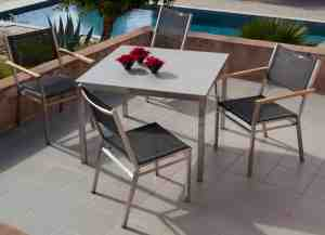 Equinox Ceramic top table in ASH. Equinox chairs in Charcoal